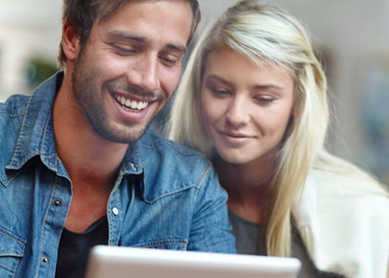 Couple looking at laptop screen