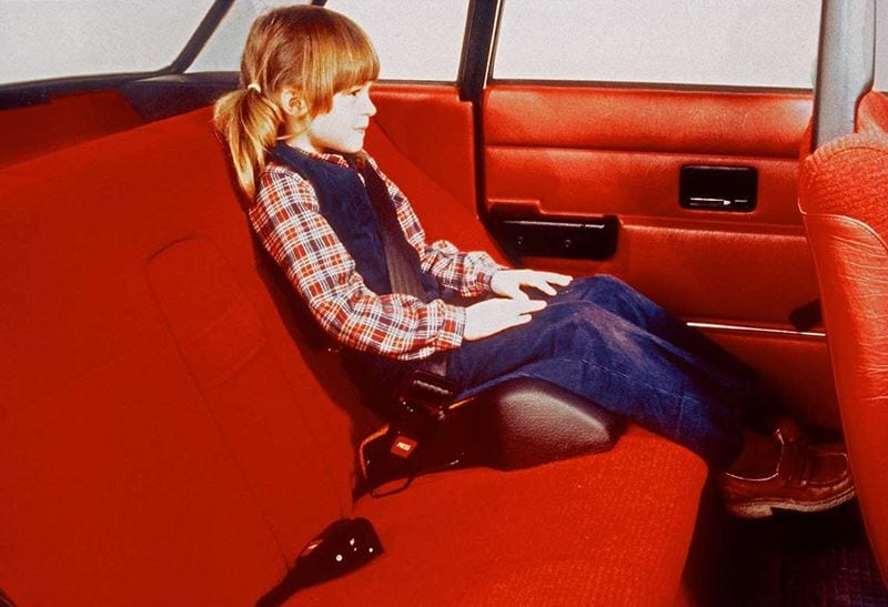 A girl sitting in a booster seat